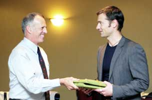 Justin Straker accepts the Book Award from Bill Price, NRCan.